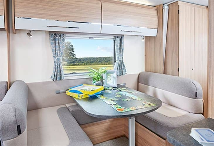 A family enjoying the living area of the Bailey 2020 Pegasus Grande Turin