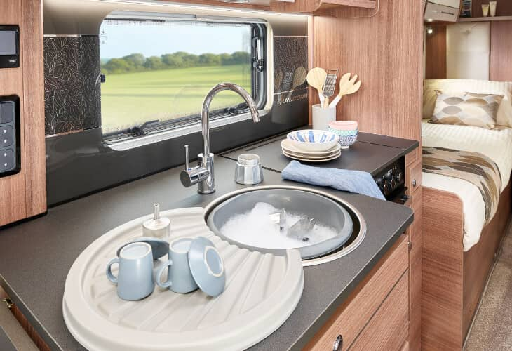 A view of the kitchen and sink in the Bailey 2020 Unicorn IV Black Edition Vigo