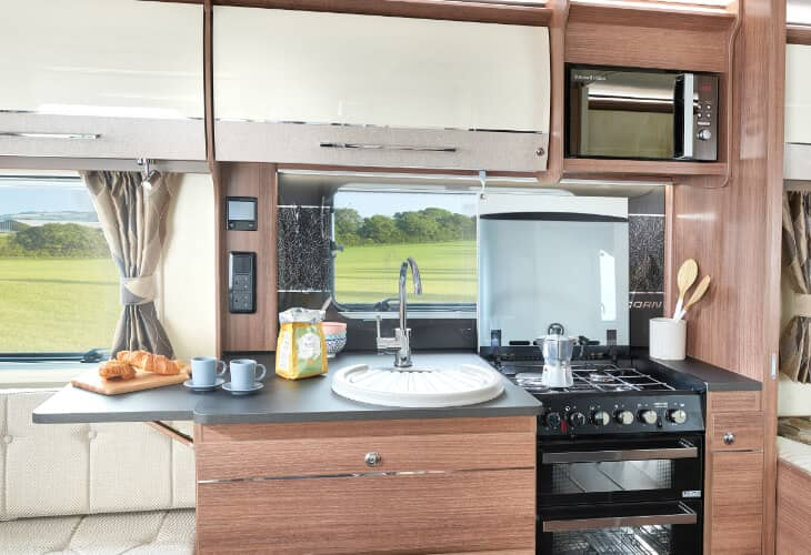 A view of the kitchen area of the Bailey 2020 Unicorn IV Black Edition Vigo