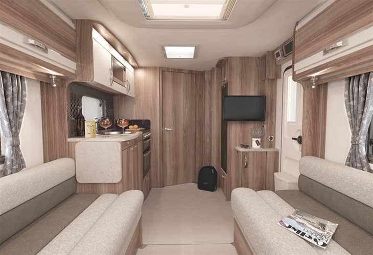 A family enjoying the living area in the Swift 2020 Challenger X 850